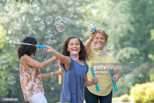 Multi-Generation Family of Women Playing with Bubbles
