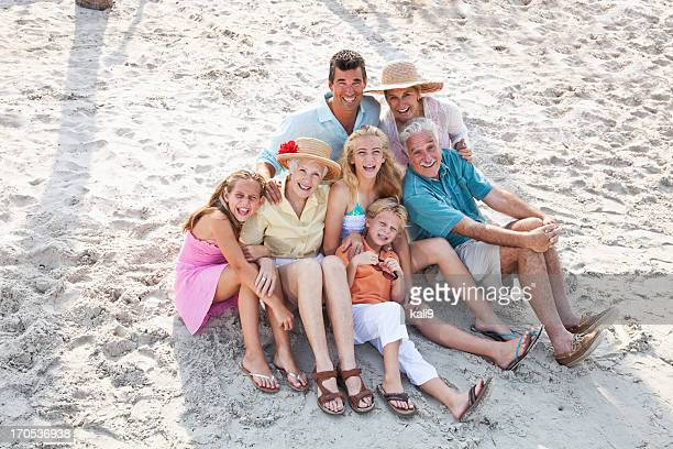 Multi-generation family on beach