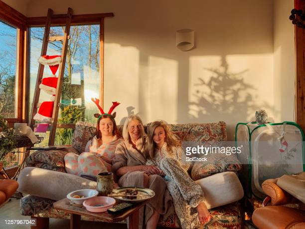 multi-generation family on christmas day - 12 17 months stock pictures, royalty-free photos & images