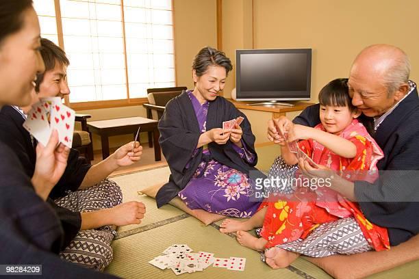 Multi-generation family playing cards in Yukata