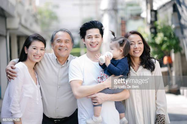 Multi-generation family portrait outdoors