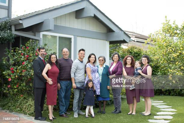 multi-generation family posing near house - in law relations stock pictures, royalty-free photos & images