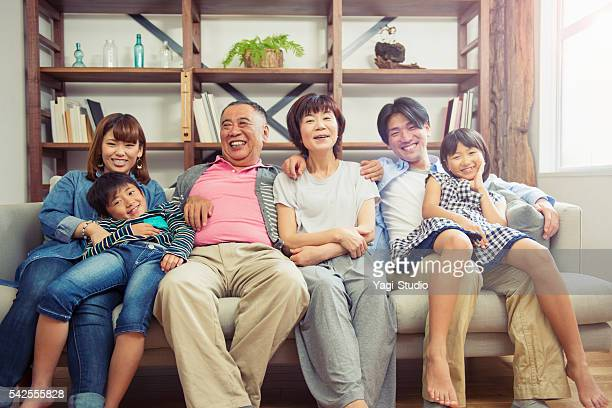 Multi-generation family relaxing at home