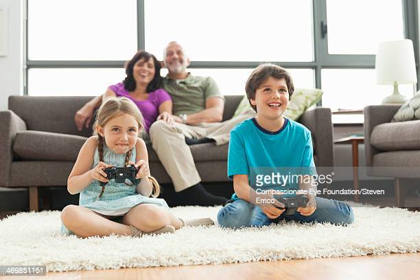 Multi-generation family relaxing in living room