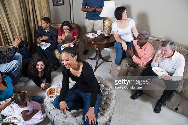 Multi-generation family relaxing together in living room