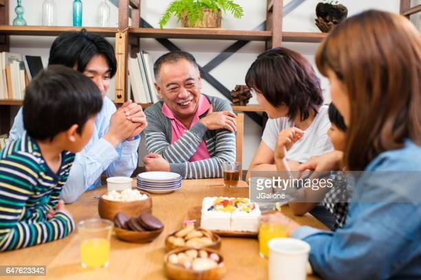 Multi-generation family sat around table