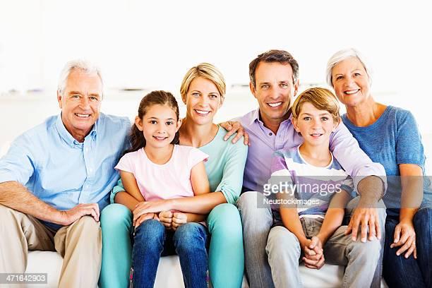Multi-Generation Family Sitting Together On Sofa