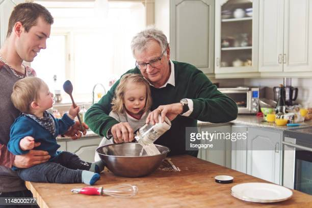 multi-generation family spending time together for father's day - happy fathers day stock pictures, royalty-free photos & images