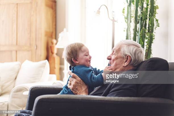 multi-generation family spending time together for father's day - fathers day stock pictures, royalty-free photos & images