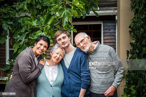 multi-generation family standing together in yard - grandmother photos stock pictures, royalty-free photos & images