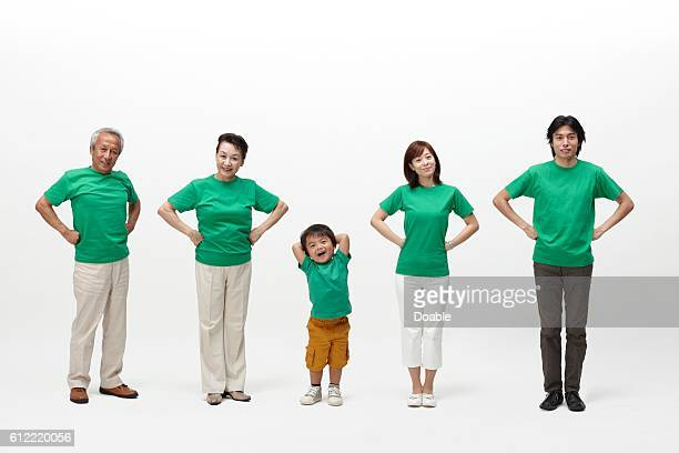 Multi-generation family standing with hand on hip