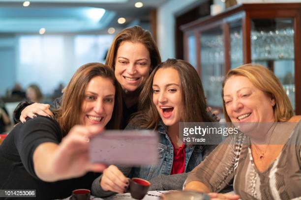 multi-generation family taking a selfie - four people stock pictures, royalty-free photos & images
