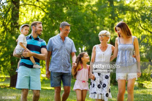 Multi-generation family taking a walk in the park