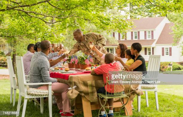 Multi-generation family toasting with lemonade at picnic