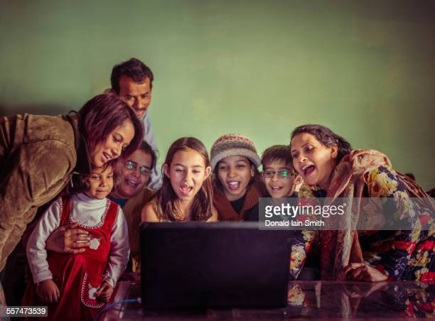 Multi-generation family videochatting on laptop