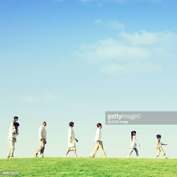 Multi-generation Family Walking In Park