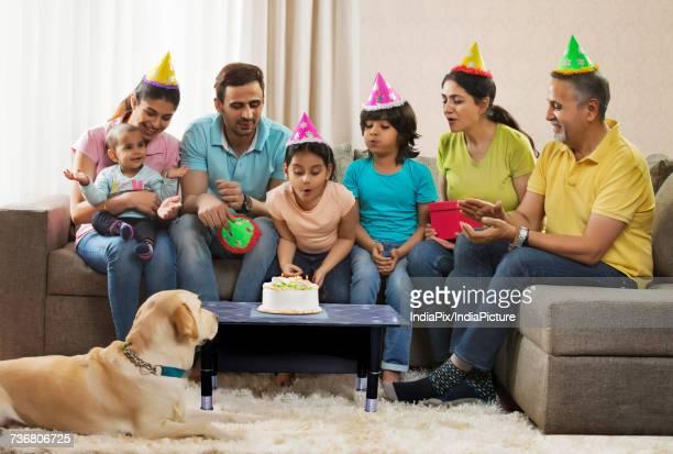 Multi-generation family with dog celebrating birthday party