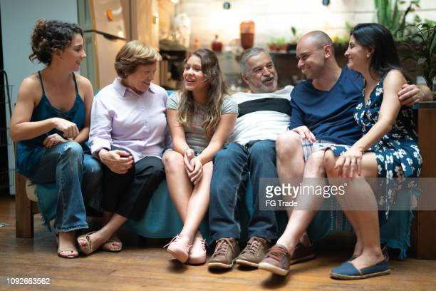 multi-generation hispanic-latino family at home - family at home stock photos and pictures