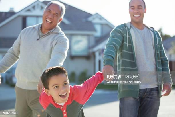 Multi-generation men laughing outdoors