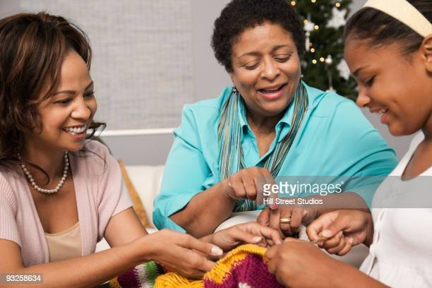 multi-generation women knitting - gardena california stock pictures, royalty-free photos & images