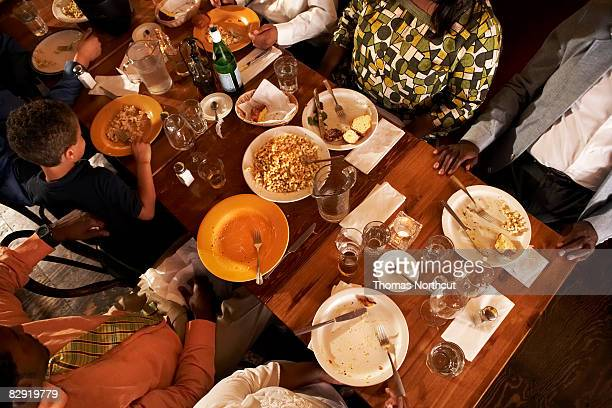Multigenerational, African American family dining