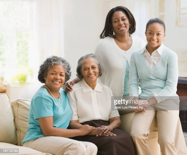multi-generational african women sitting on sofa - great grandmother stock pictures, royalty-free photos & images