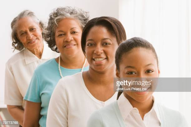 multi-generational african women standing in row - great grandmother stock pictures, royalty-free photos & images