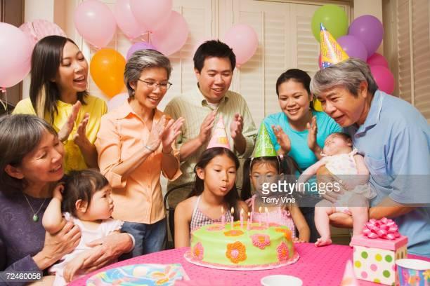 Multi-generational Asian family celebrating birthday