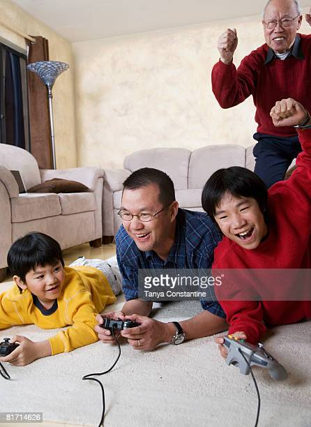 Multi-generational Asian family playing video games