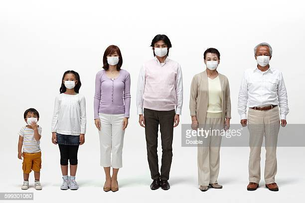 Multi-generational family all wearing surgical masks