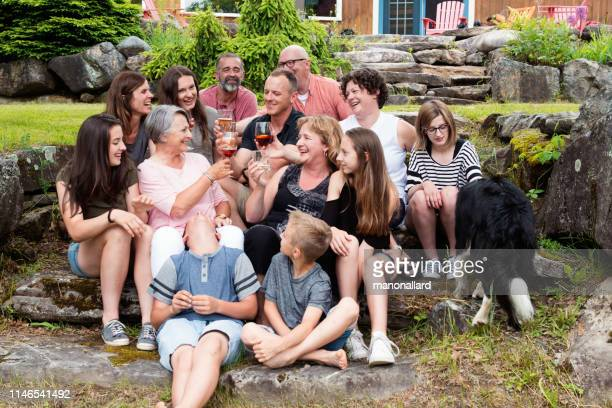 multi-generational family celebrate mother's day - large family stock pictures, royalty-free photos & images