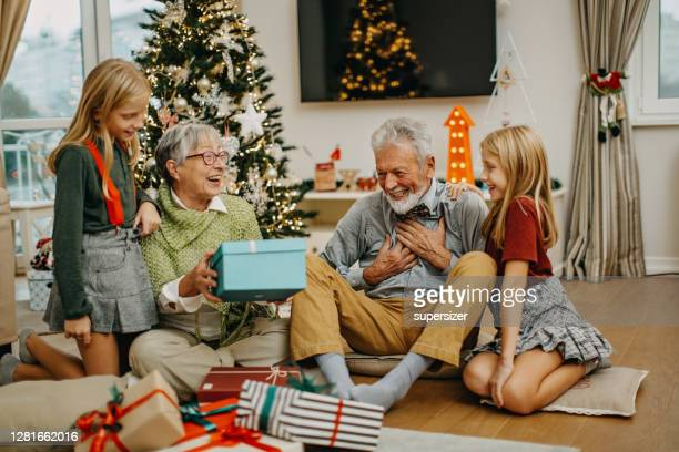 multigenerational family celebrates christmas-new year - 70 year old man stock pictures, royalty-free photos & images