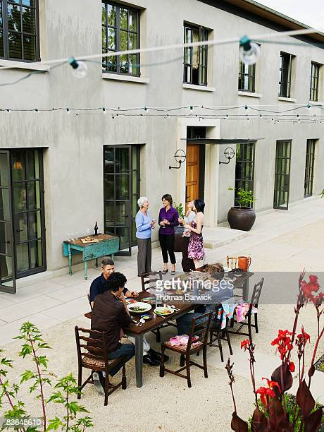 Multigenerational family dining outside of home
