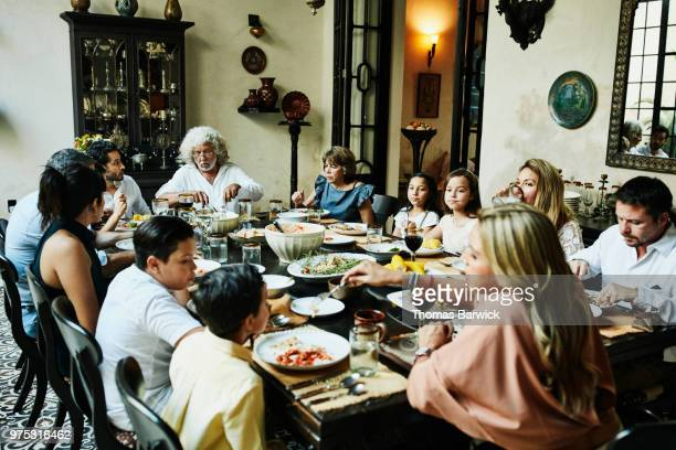 Multigenerational family dining together during celebration dinner