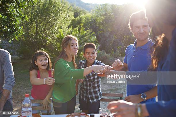 multigenerational family eating olives outside - klaus vedfelt mallorca stock pictures, royalty-free photos & images