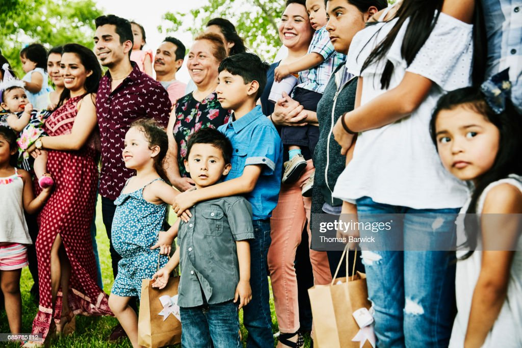 Multigenerational family having birthday party gathered for family portrait : Stock Photo