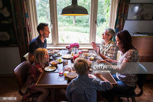 Multi-generational family having breakfast