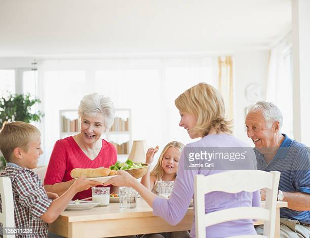 Multi-generational family having dinner together