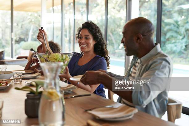 multigenerational family having weekend lunch - black family dinner stock photos and pictures
