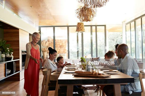 multigenerational family having weekend lunch - generational family stock photos and pictures