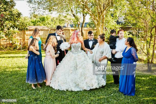 Multigenerational family in backyard before quinceanera