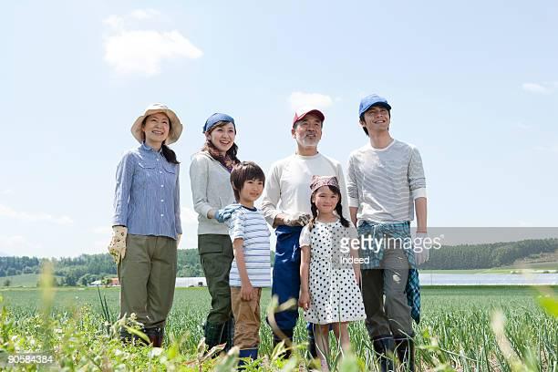 Multi-generational family in field