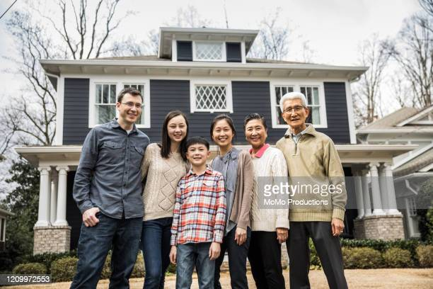 multi-generational family in front of home - mixed race person stock pictures, royalty-free photos & images