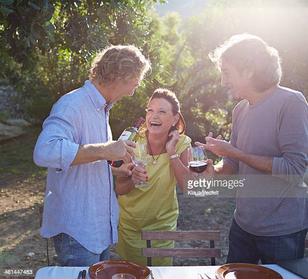 Multigenerational family laughing together outside