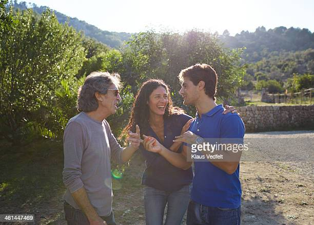 multigenerational family laughing together - klaus vedfelt mallorca stock pictures, royalty-free photos & images