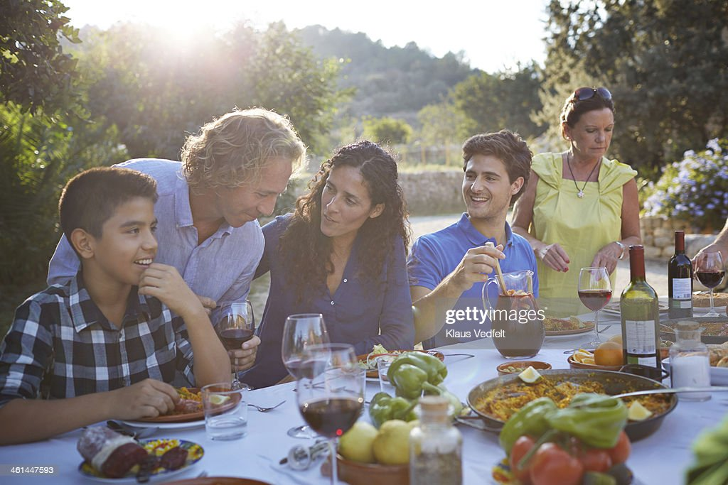 Multigenerational family laughing together : Stock Photo