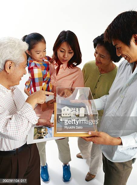 Multi-generational family looking at model house