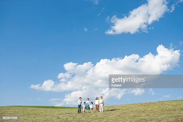 Multi-generational family on field