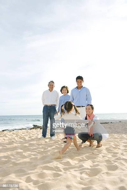 Multigenerational family playing on beach
