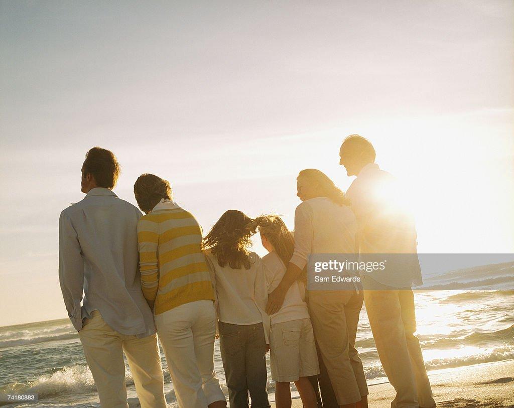Multigenerational family portrait outdoors at sunset : Stock Photo